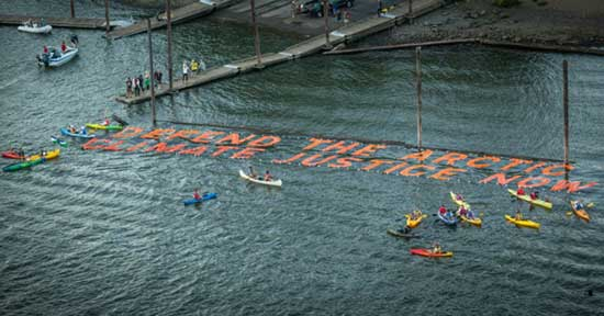Activists Dangle From Bridge To Block Shell Oil Drilling and its Working