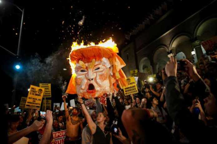 Trump protesters flood streets anew