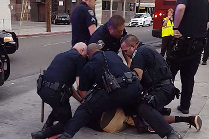 State Law Requires Bystanders To Help Police Make Arrests